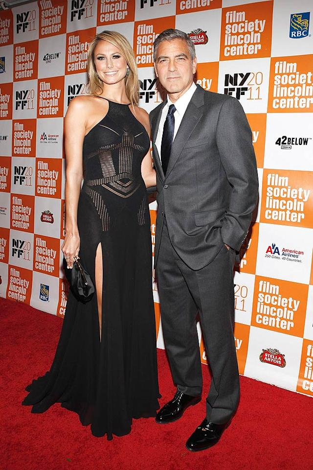 """And last but not least ... George Clooney and his new gal pal, Stacy Keibler, at the New York Film Festival premiere of """"The Descendants."""" Are you fond of the new power couple? More importantly, are you fond of her revealing Versace gown? Discuss! (10/16/11)"""
