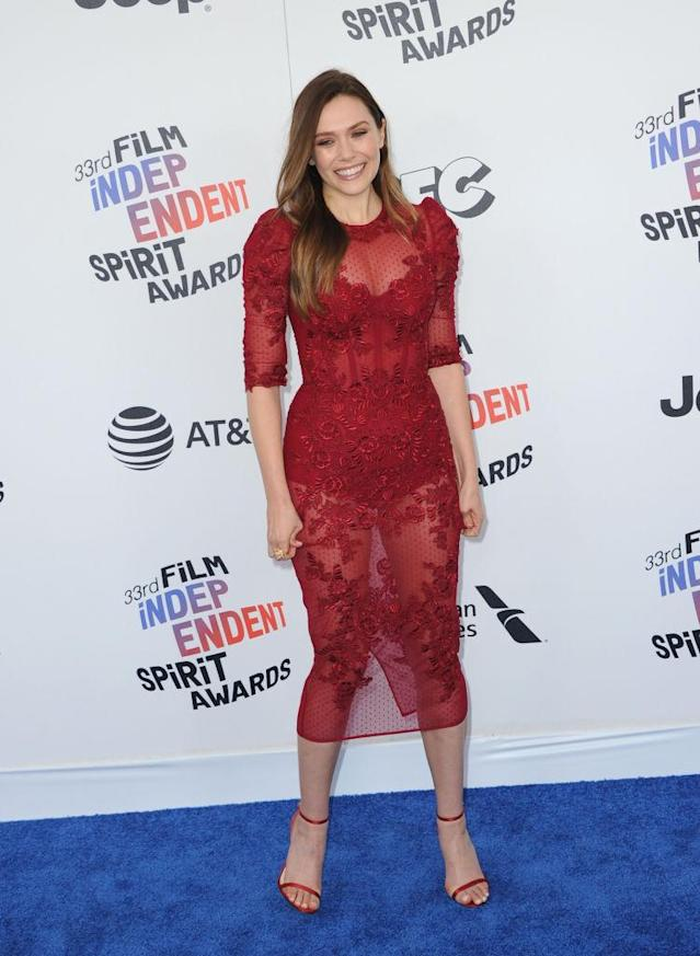 <p>The <em>Ingrid Goes West</em> star showed some skin in a red illusion dress with matching heels. (Photo: Getty Images) </p>