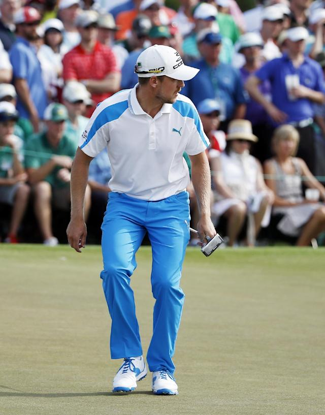 Jonas Blixt, of Sweden, watches as his ball misses the cup on the ninth green during the fourth round of the Masters golf tournament Sunday, April 13, 2014, in Augusta, Ga. (AP Photo/Matt Slocum)