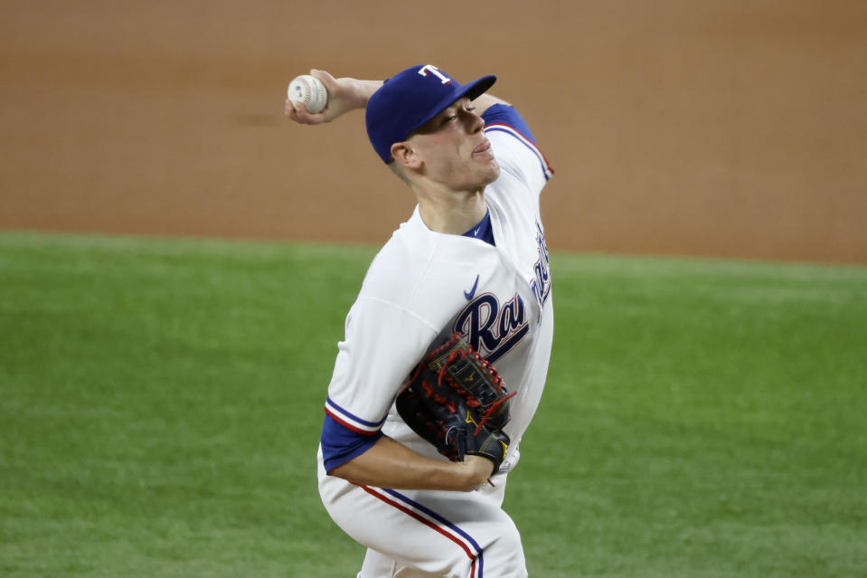 Texas Rangers starting pitcher Kolby Allard throws against the Minnesota Twins during the first inning of a baseball game Saturday, June 19, 2021, in Arlington, Texas. (AP Photo/Michael Ainsworth)