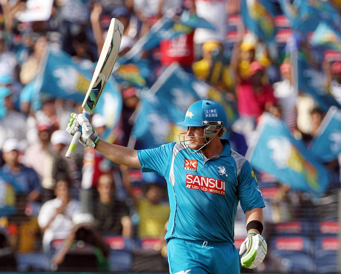 Pune Warriors captain Aaron Finch raises his bat after scoring a fifty during match 71 of the Pepsi Indian Premier League ( IPL) 2013  between The Pune Warriors India and the Delhi Daredevils held at the Subrata Roy Sahara Stadium, Pune on the 19th May 2013. (BCCI)