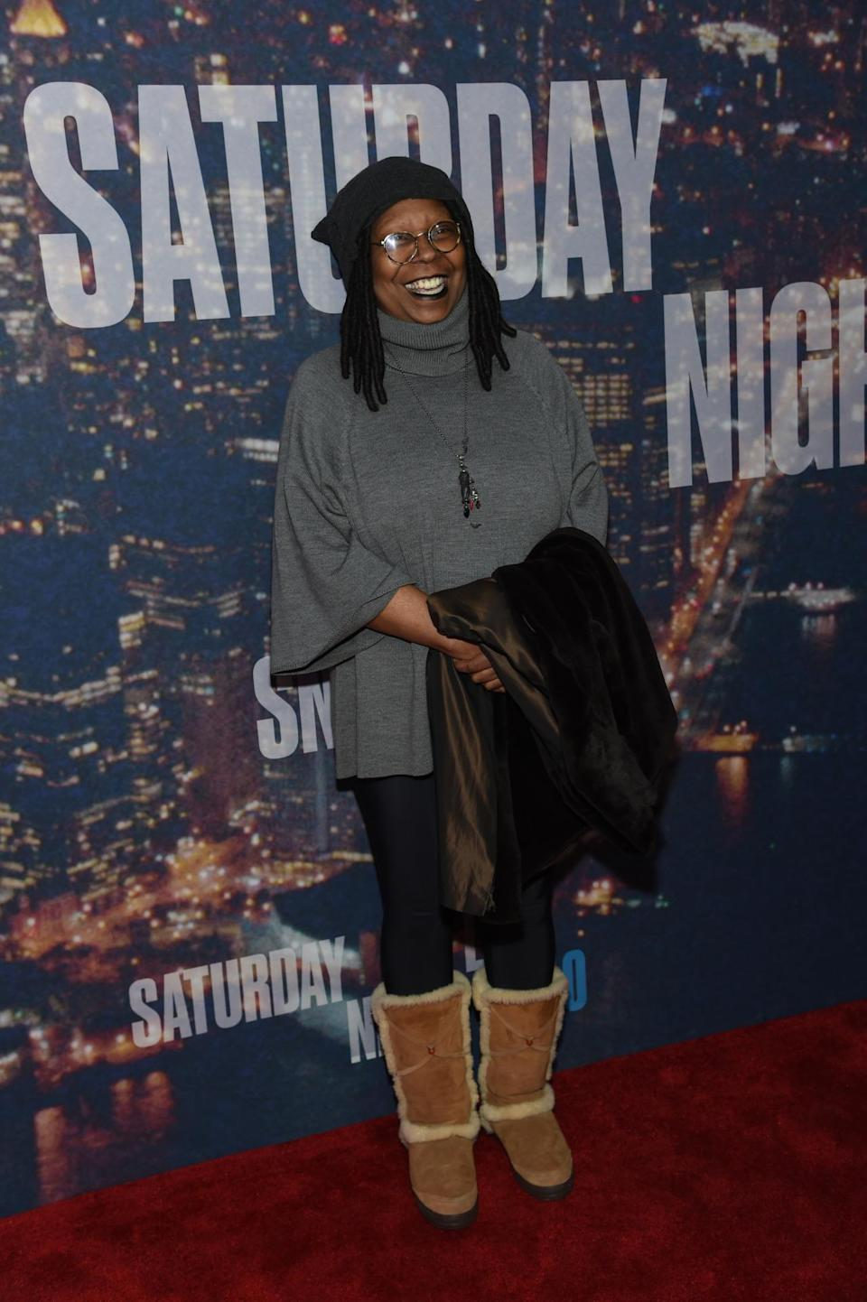 While most of the other guests wore outfits in accordance with the momentous occasion, Whoopi Goldberg opted for comfort in a sweater, hat, and Ugg boots.