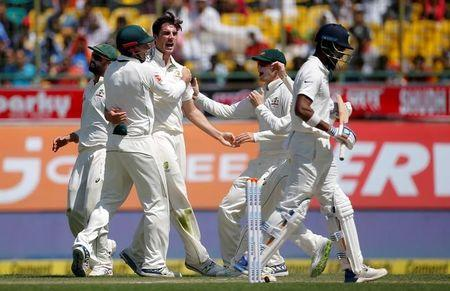 Cricket - India v Australia - Fourth Test cricket match - Himachal Pradesh Cricket Association Stadium, Dharamsala, India - 26/03/17 - Australia's Pat Cummins (C) celebrates with his team-mates after dismissing India's Lokesh Rahul. REUTERS/Adnan Abidi