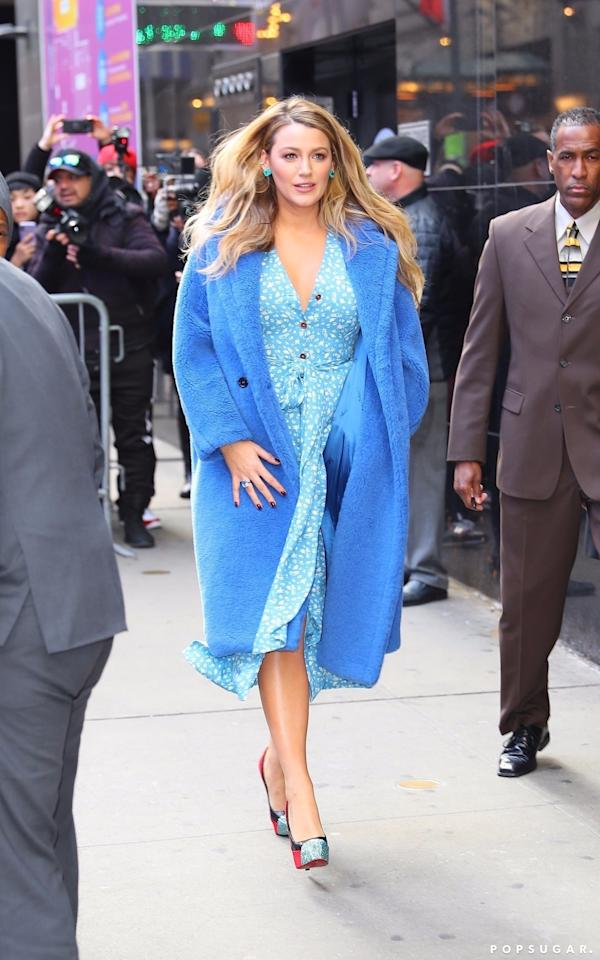 <p>Wearing a cobalt blue Max Mara coat with a floral Ulyana Sergeenko dress. She finished her look off with Christian Louboutin heels.</p>