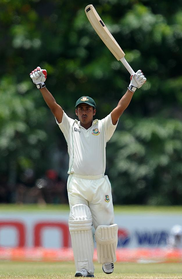 Bangladeshi cricketer Mohammad Ashraful raises his bat in celebration after scoring a century (100 runs) during the third day of the opening Test match between Sri Lanka and Bangladesh at the Galle International Cricket Stadium in Galle on March 10, 2013.   AFP PHOTO/ LAKRUWAN WANNIARACHCHI        (Photo credit should read LAKRUWAN WANNIARACHCHI/AFP/Getty Images)