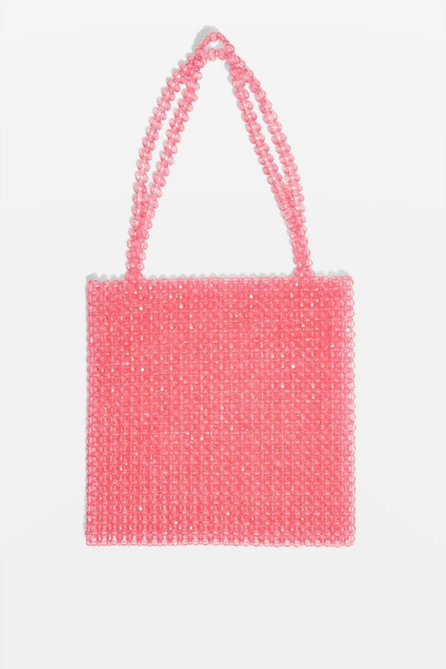 """<p>Bead bags are all the rage at the moment, thanks to Shrimps' now-cult Antonia bag. The great thing about this Topshop version is that it won't set you back £450 like the original. Win. <em><a rel=""""nofollow"""" href=""""http://www.topshop.com/en/tsuk/product/beaded-tote-bag-7638821?geoip=noredirect&cmpid=ppc_pla_UK_ip&utm_medium=cpc&tsrc=vdna&istCompanyId=38aa0d7f-6514-4cb3-bbdc-df0d32d48b7f&istItemId=-xlxmwiriti&istBid=tztx&utm_content=&gclid=EAIaIQobChMI-_rlva7i2gIVDp3tCh27UwLZEAQYASABEgJsGfD_BwE&gclsrc=aw.ds"""">Buy here.</a> </em> </p>"""