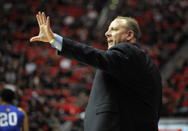 San Jose State head coach Dave Wojcik yells from the sidelines during the first half of an NCAA college basketball game against San Diego State, Tuesday, Feb. 25, 2014, in San Diego. (AP Photo/Denis Poroy)