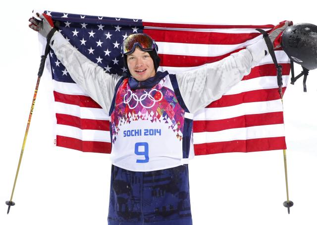 Winner David Wise of the U.S. celebrates with his country's flag after the men's freestyle skiing halfpipe finals at the 2014 Sochi Winter Olympic Games in Rosa Khutor February 18, 2014. REUTERS/Lucas Jackson (RUSSIA - Tags: SPORT OLYMPICS SPORT SKIING)
