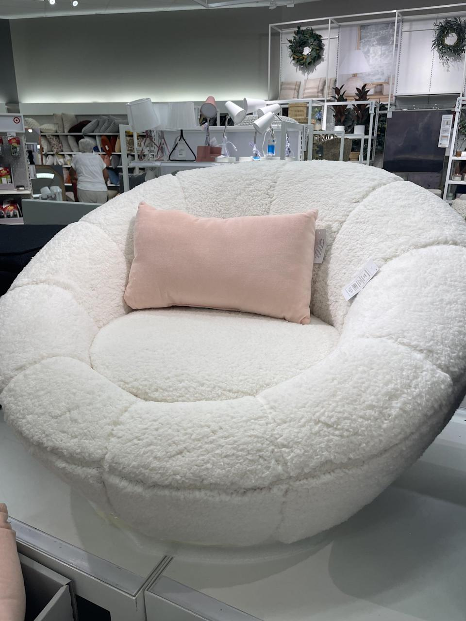 <p>I sat in this <span>Room Essentials Sherpa Swivel Tulip Chair</span> ($119) and can confirm it's incredibly comfortable. It's like sitting on a cloud. Plus the fact that it swivels all the way around is so genius.</p>