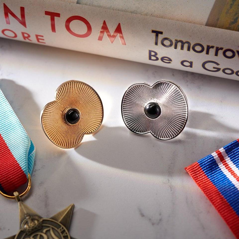 The Captain Tom poppy pins have 100 laser edged ridges to symbolise the veteran's 100 years, his 100 laps of his garden and 100 years of the Royal British Legion charity. (Royal British Legion/ PA)