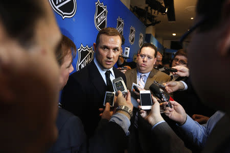 Yzerman, general manager of Tampa Bay Lightning, speaks to media before Commissioner Bettman announces end of labor negotiations between the NHL and NHLPA in New York