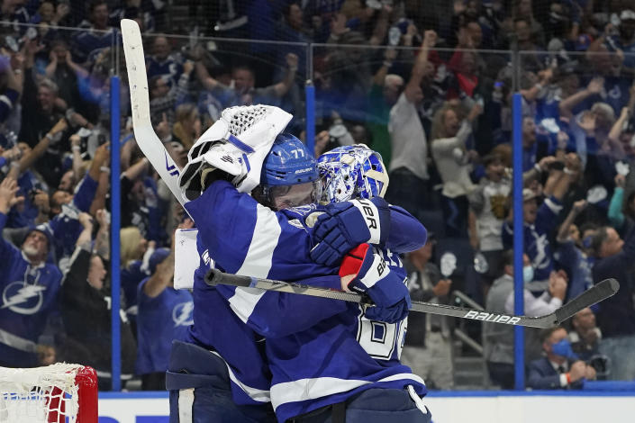 Tampa Bay Lightning defenseman Victor Hedman, left, and goaltender Andrei Vasilevskiy celebrate after defeating the New York Islanders in Game 7 of an NHL hockey Stanley Cup semifinal playoff series Friday, June 25, 2021, in Tampa, Fla. (AP Photo/Chris O'Meara)