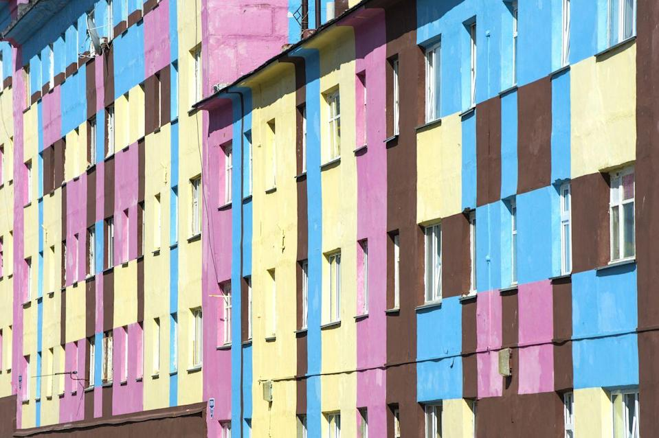 <p>An otherwise plain building in Russia is enlivened with stripes of color.</p>