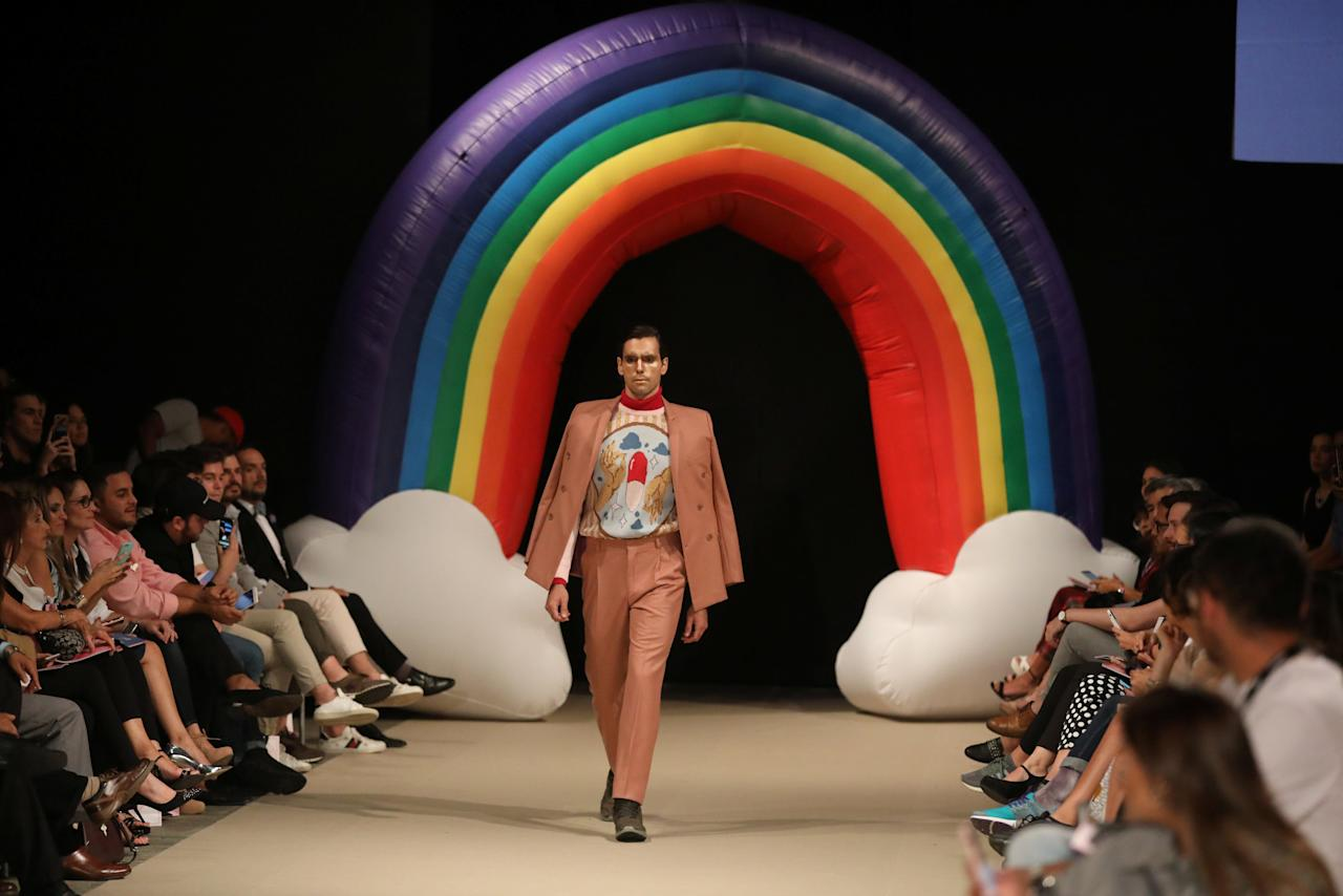 A model presents a creation of Peruvian designer Edward Venero during Fashion Week in Lima, Peru, April 25, 2018. REUTERS/Guadalupe Pardo