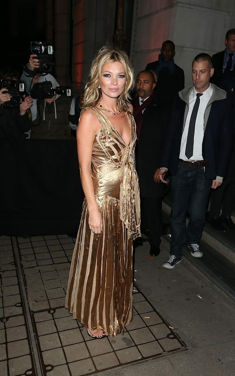 Kate Moss in gold at her 2012 book launch - Getty Images