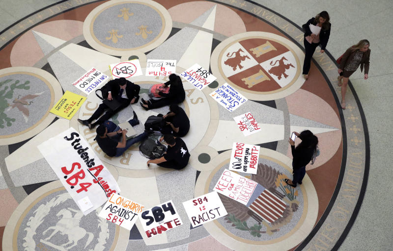 "Students gather in the Rotunda at the Texas Capitol to oppose SB4, an anti-""sanctuary cities"" bill that already cleared the Texas Senate and seeks to jail sheriffs and other officials who refuse to help enforce federal immigration law, as the Texas House prepares to debate the bill, Wednesday, April 26, 2017, in Austin, Texas. (AP Photo/Eric Gay)"