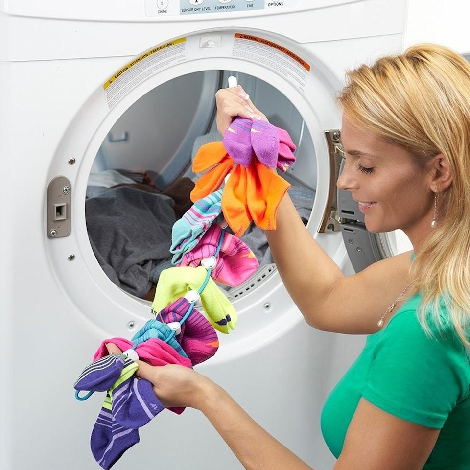 """Just attach your socks in pairs on this clever clip and throw them in the wash. This will keep them together and save you <i>loads</i> of time whenever you do laundry.<br /><br /><strong>Promising review:</strong>""""These work. They are of good quality construction. I had a sock problem, and<strong>these have stopped the unexplained disappearance of socks.</strong>Obviously, the sock monster can't swallow the Sock Dock full of socks, only single socks."""" —<a href=""""https://amzn.to/3e9UbvW"""" target=""""_blank"""" rel=""""nofollow noopener noreferrer"""" data-skimlinks-tracking=""""5902331"""" data-vars-affiliate=""""Amazon"""" data-vars-href=""""https://www.amazon.com/gp/customer-reviews/RGL4XLUQTABEF?tag=bfmal-20&ascsubtag=5902331%2C23%2C37%2Cmobile_web%2C0%2C0%2C16540735"""" data-vars-keywords=""""cleaning"""" data-vars-link-id=""""16540735"""" data-vars-price="""""""" data-vars-product-id=""""15939327"""" data-vars-retailers=""""Amazon"""">A.D. Burnette</a><br /><br /><strong>Get it from Amazon for<a href=""""https://amzn.to/2RyIxTH"""" target=""""_blank"""" rel=""""nofollow noopener noreferrer"""" data-skimlinks-tracking=""""5902331"""" data-vars-affiliate=""""Amazon"""" data-vars-asin=""""B07BXJ32Q8"""" data-vars-href=""""https://www.amazon.com/dp/B07BXJ32Q8?tag=bfmal-20&ascsubtag=5902331%2C23%2C37%2Cmobile_web%2C0%2C0%2C16540664"""" data-vars-keywords=""""cleaning"""" data-vars-link-id=""""16540664"""" data-vars-price="""""""" data-vars-product-id=""""18051235"""" data-vars-product-img=""""https://m.media-amazon.com/images/I/51Nn2sfq5rL.jpg"""" data-vars-product-title=""""SockDock Sock Laundry Tool & Storage Hanger for Washing Drying & Storing Paired Socks, Clips & Locks, No Sorting or Matching, Foldable Closet Organizer Better Than Mesh Bag, 2-Pack (Blue)"""" data-vars-retailers=""""Amazon"""">$16</a>(available in three colors).</strong>"""