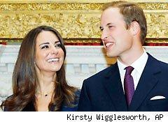 Britain's Prince William and his fiancee Kate Middleton pose for the media