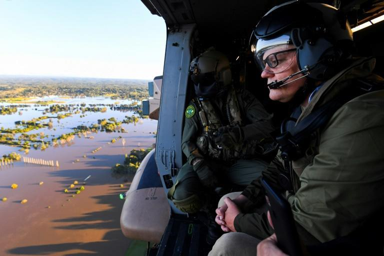 Australian Prime Minister Scott Morrison surveys the floods around Sydney from an army helicopter
