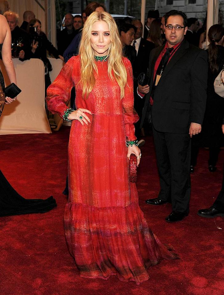 "Mary-Kate Olsen stepped out in a long-sleeve ruffled red vintage Givenchy frock with bright green accents. We think the billionaire looked like she was dressed more appropriately for a folk music fest than a black tie gala. Larry Busacca/<a href=""http://www.gettyimages.com/"" target=""new"">GettyImages.com</a> - May 2, 2011"