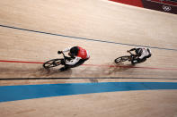 Nicholas Paul of Team Trinidad And Tobago, left, and Yuta Wakimoto of Team Japan competes during the track cycling men's sprint race at the 2020 Summer Olympics, Thursday, Aug. 5, 2021, in Izu, Japan. (AP Photo/Thibault Camus)