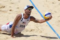 <p>TOKYO, JAPAN - JULY 29: Nicholas Lucena #2 of Team United States dives for the ball against Team Argentina during the Men's Preliminary - Pool D beach volleyball on day six of the Tokyo 2020 Olympic Games at Shiokaze Park on July 29, 2021 in Tokyo, Japan. (Photo by Sean M. Haffey/Getty Images)</p>