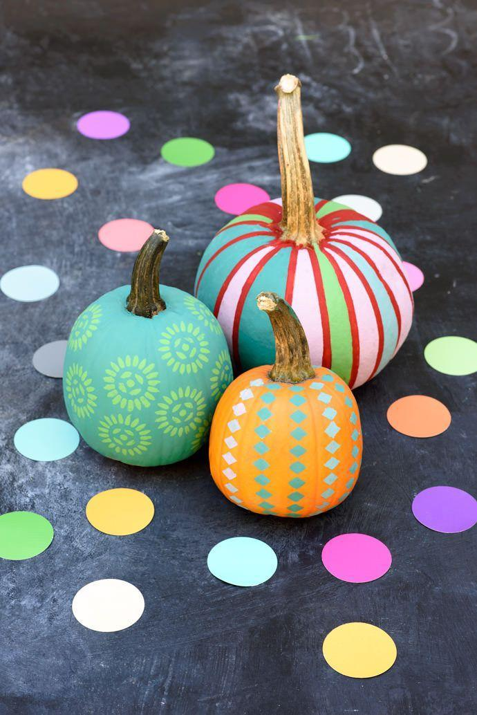 """<p>Once the base coat is on, use store-bought or handmade stencils to paint some fun patterns all over your pumpkin. </p><p><em><a href=""""http://www.handmadecharlotte.com/painted-mini-pumpkin-patch/"""" rel=""""nofollow noopener"""" target=""""_blank"""" data-ylk=""""slk:Get the tutorial at Handmade Charlotte »"""" class=""""link rapid-noclick-resp"""">Get the tutorial at Handmade Charlotte »</a></em></p>"""
