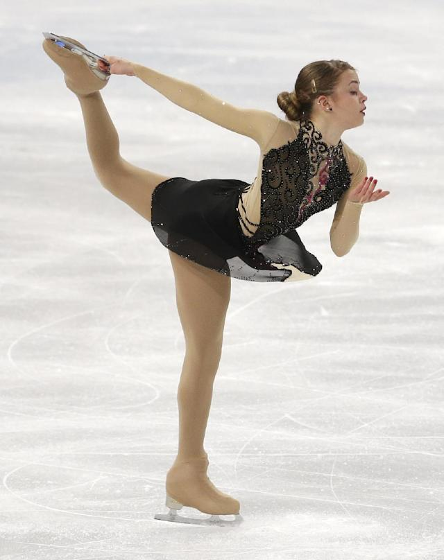 Isadora Williams of Brazil competes in the women's short program figure skating competition at the Iceberg Skating Palace during the 2014 Winter Olympics, Wednesday, Feb. 19, 2014, in Sochi, Russia. (AP Photo/Darron Cummings)