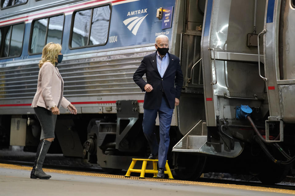 Democratic presidential candidate former Vice President Joe Biden and Jill Biden, arrive to speak at Amtrak's Pittsburgh Train Station, Wednesday, Sept. 30, 2020, in Pittsburgh. Biden is on a train tour through Ohio and Pennsylvania today. (AP Photo/Andrew Harnik)