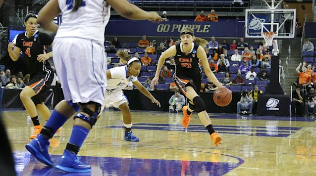 Oregon State's Sydney Wiese (21) drives past Middle Tennessee State's Ty Petty, second from right, in the first half of a first-round game in the NCAA women's college basketball tournament, Sunday, March 23, 2014, in Seattle. Oregon State beat Middle Tennessee 55-36. (AP Photo/Ted S. Warren)