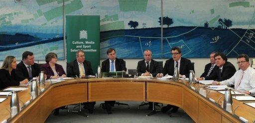 "Members of the House of Commons Culture, Media and Sport Committee launch their report entitled ""News International and Phone-Hacking"" at a press conference in London. Rupert Murdoch is not fit to lead a major global company, British lawmakers said in a scathing report Tuesday, accusing him of ""wilful blindness"" over the News of the World phone-hacking scandal"