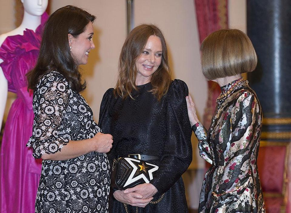 The pregnant royal mingled with the fashion industry's biggest names including designer Stella McCartney at Vogue legend, Anna Wintour [Photo: Getty]