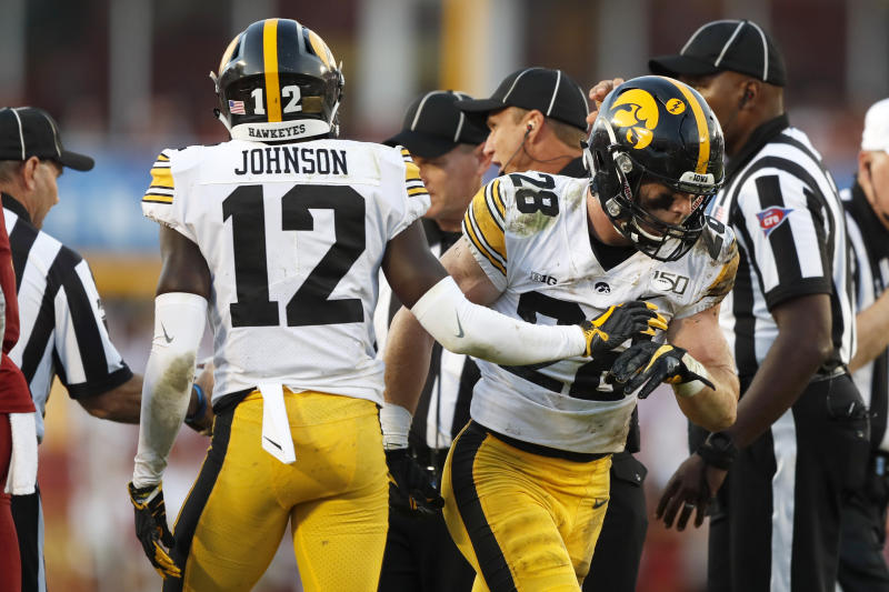 Iowa defensive back Jack Koerner (28) celebrates with teammate D.J. Johnson (12) after recovering a fumble during the first half of an NCAA college football game against Iowa State, Saturday, Sept. 14, 2019, in Ames, Iowa. (AP Photo/Charlie Neibergall)