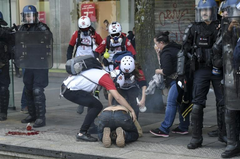 "So-called ""street medics"" help a demonstrator during an ""yellow vest"" protest in Nantes, western France"