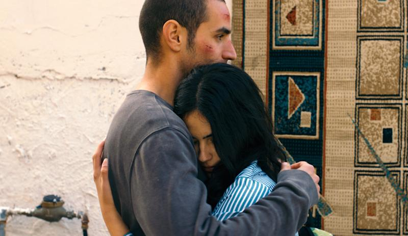 "This film image released by Adopt Films shows Adam Bakri, left, and Leem Lubany in a scene from the film ""Omar."" The film was nominated for an Academy Award for best foreign picture on Thursday, Jan. 16, 2014. The 86th Academy Awards will be held on March 2. (AP Photo/Adopt Films)"