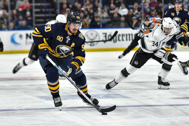 Buffalo Sabres center Marcus Johansson (90) skates with the puck during the second period of an NHL hockey game against the Los Angeles Kings in Buffalo, N.Y., Saturday, Nov. 21, 2019. (AP Photo/Adrian Kraus)