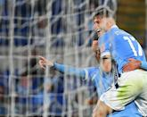 Ciro Immobile (R) headed in his fourth league goal of the season
