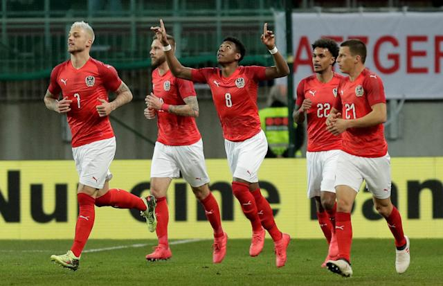 Soccer Football - International Friendly - Austria vs Slovenia - Worthersee Stadium, Klagenfurt, Austria - March 23, 2018 Austria's David Alaba celebrates with team mates after scoring their first goal REUTERS/Heinz-Peter Bader
