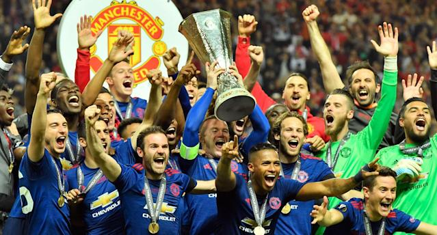Captain Rooney and the Red Devils celebrate their Europa League title. (AP Photo)