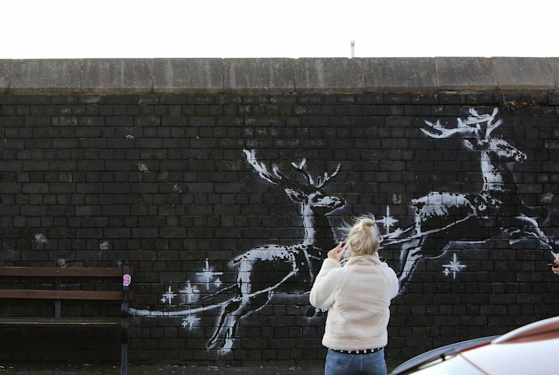 Crowds flocked to see the mural before it was defaced (Picture: SWNS)