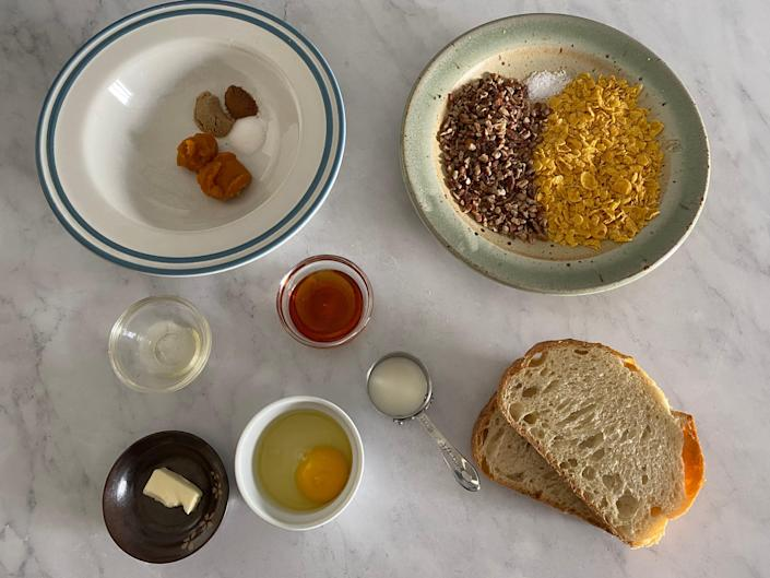 The ingredients for the pumpkin pecan french toast arranged on a white counter