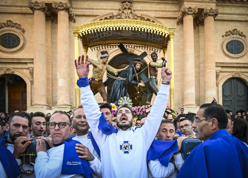 Christians participate in a Good Friday procession in front of the Basilica of the Santissima Annunziata on April 19, 2019 in Ispica, Italy.  (Fabrizio Villa via Getty Images)