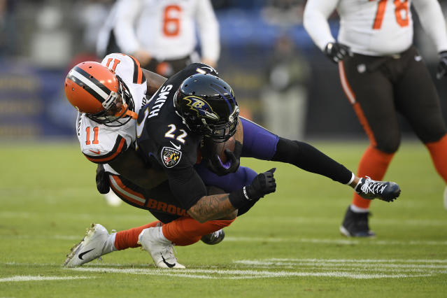 Baltimore Ravens cornerback Jimmy Smith (22) intercepts a pass in front of Cleveland Browns wide receiver Antonio Callaway in the first half of an NFL football game, Sunday, Dec. 30, 2018, in Baltimore. (AP Photo/Nick Wass)