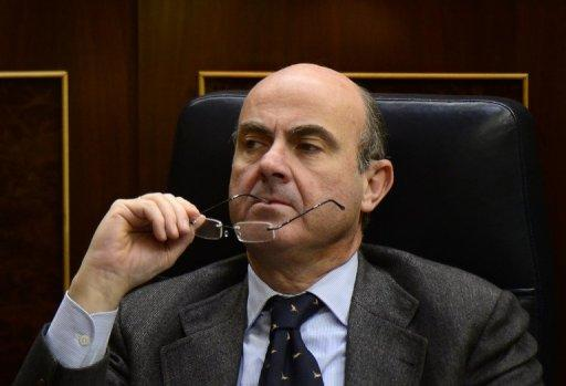 Spain's Economy Minister Luis de Guindos attends parliament in Madrid on December 20, 2012