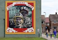 Landmarks around Seaham like a mural by artist Cosmo Sarson remind of the town's coal-mining past (AFP/PAUL ELLIS)