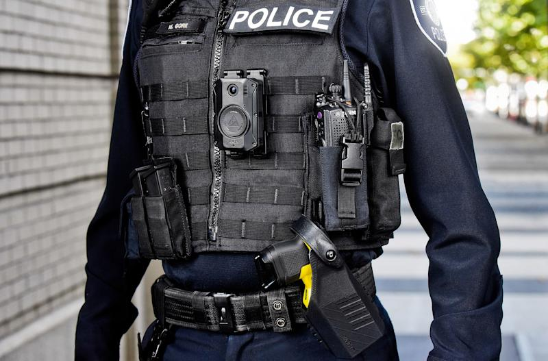 Police officer wearing Axon 3 body camera and Taser 7.