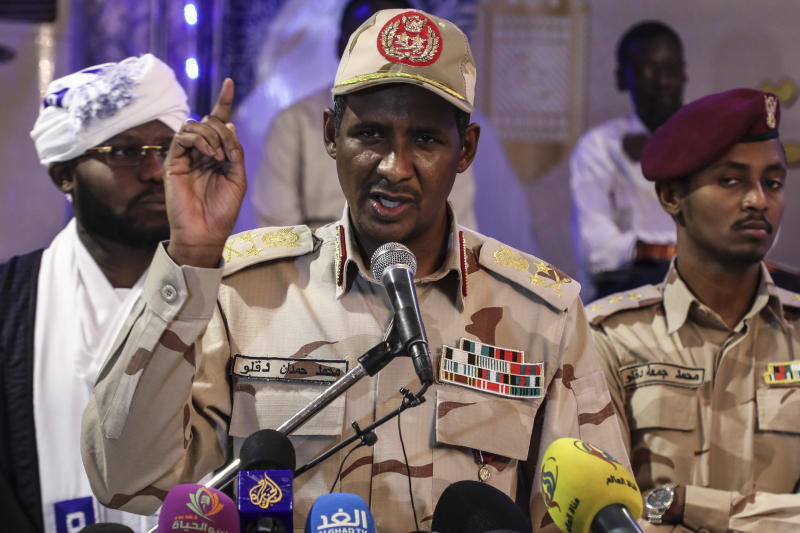 In this Saturday, May 18, 2019 photo, Gen. Mohammed Hamdan Dagalo, better known as Hemedti, the deputy head of the military council that assumed power in Sudan after the overthrow of President Omar al-Bashir, speaks to journalists in Khartoum, Sudan. At 44, he is the youngest member of the council. He says he refused orders from al-Bashir to fire on the protesters, and he praised them as recently as last weekend. (AP Photo)