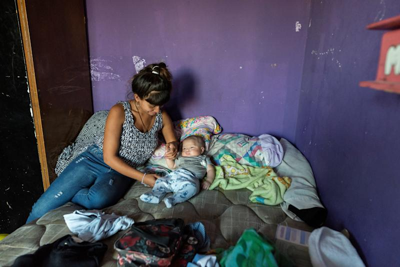 "Luli, 19, plays with her son at her home in Villa 31, a populous and marginalised shantytown neighbourhood in Buenos Aires, Argentina, March 29, 2019. Luli has gone through a year of treatment since contracting the disease while she was pregnant. She says her now months-old baby luckily did not get infected. Luli lives in a flat with one bedroom, a kitchen and no bathroom together with her son and partner. The three sleep in one room. ""We are constantly moving fromone house to another because of the high price of the rent,"" she said. (Photo: Magali Druscovich/Reuters)"
