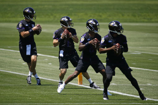 Baltimore Ravens quarterbacks Joe Flacco, left, runs a drill alongside fellow quarterbacks Josh Woodrum, second from left, Lamar Jackson and Robert Griffin III during an NFL football organized team activity at the team's headquarters in Owings Mills, Md., Thursday, May 24, 2018. (AP Photo/Patrick Semansky)