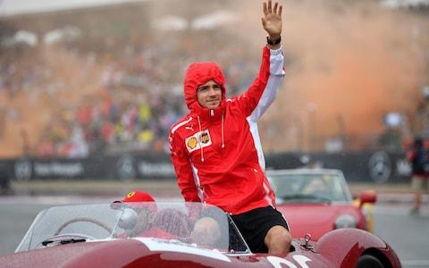 Charles Leclerc of Monaco and Ferrari waves to the crowd on the drivers parade before the F1 Grand Prix of Germany at Hockenheimring on July 28, 2019 in Hockenheim, Germany. - Credit: Getty Images Europe